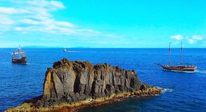 Two sailing boat and a boat in the ocean. Madeira, Funchal, Portugal.  stock photography