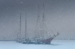 Two sailing boats in a heavy blizzard Royalty Free Stock Photography