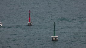 Two sailing boats meet while passing the red and green markers stock video footage