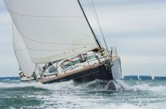 Two Sailing Boat Yachts Racing at Sea royalty free stock images