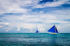 Two sailing boats in the sea, Boracay Island, Philippines Stock Photos