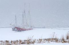 Two sailing boats trapped in a heavy snowstorm Royalty Free Stock Image