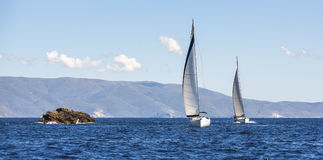 Two sailing boats yacht or sail regatta race on blue water Sea. Sport. Stock Image