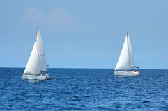 Two sailing ships. On open sea Stock Photo