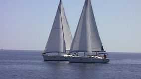 Two sailing yacht at sea. In the Mediterranean Sea stock video