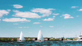 Two sailing yachts pass the canal Stock Image