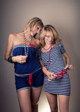 Two Sailor Girls Have A Fun Stock Image