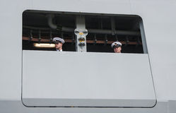 Two sailors of the Danish frigate HDMS Niels Juel (F363). SZCZECIN, POLAND - MAY 14, 2014: Two sailors of the Danish frigate HDMS Niels Juel (F363). The frigate Stock Photography