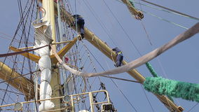 Two sailors on the mast of the sailing ship stock footage