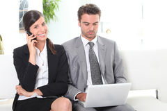 Two sales people waiting Royalty Free Stock Photography
