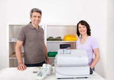 Two sales  persons in the shop Stock Image