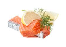 Two salmon pieces with lemon and dill. Isolated on white Stock Images