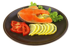 Two salmon steak on dark dish Royalty Free Stock Photography