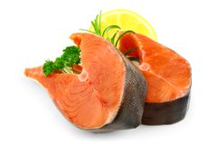 Two salmon steaks with lemon and spice Royalty Free Stock Image