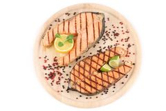 Two salmon steaks on platter. Royalty Free Stock Photo