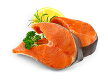 Two salmon steaks with spice and lemon Royalty Free Stock Image