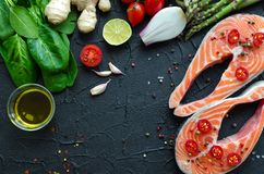 Two Salmon Steaks With Vegetables And Spices Stock Image