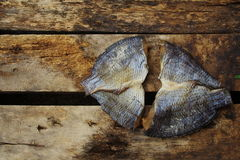 Two Salted Fish on the Old Wood Stock Photography