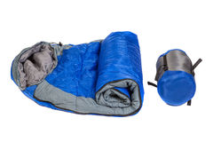 Two of the same sleeping bags in a compression bags and unpacke. D isolated on white background. Studio shot stock image