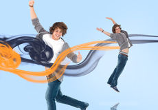 Two of the same young man jumping for joy Royalty Free Stock Photography