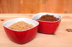 Two samples of brown and dark brown sugar Stock Photos