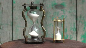 Two sand clocks with running sand, 4K stock video footage