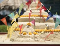 Two sand pagoda in songkran festival. Two sand pagodas decorated with colorful flags and flowers in Songkran festival Thailand Royalty Free Stock Photo