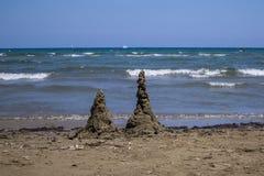 Sand castles on the beach stock photos