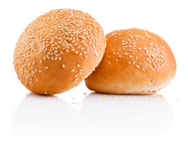 Two sandwich bun with sesame seeds isolated on white background Stock Photo