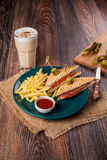 Two sandwich with fries and a drink Royalty Free Stock Photography