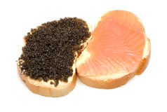 Two sandwiches. Sandwiches with a salmon and sturgeon caviar it is isolated on a white background Royalty Free Stock Photography