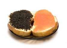 Two sandwiches. Sandwiches with a salmon and sturgeon caviar it is isolated on a white background Royalty Free Stock Photos