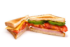Two Sandwiches. With Ham, Tomato, Bell Pepper and Cheese isolated on white Royalty Free Stock Photo