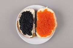 Two sandwiches with butter and caviar. Royalty Free Stock Photos