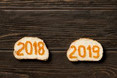 Two sandwiches with butter an red caviar in the shape of 2018 and 2019 stock photos