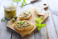 Two sandwiches with green olives paste Stock Image