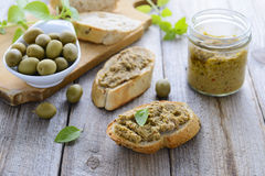 Two sandwiches with  pate of green olives. Cretan cuisine Royalty Free Stock Photos