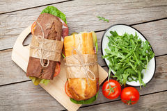 Two sandwiches with salad, ham, cheese and tomatoes Royalty Free Stock Images