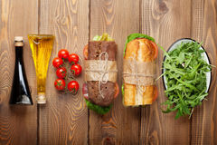 Two sandwiches with salad, ham, cheese and tomatoes Stock Photography