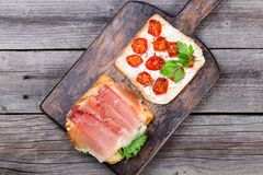 Two sandwiches on wood desk royalty free stock photography