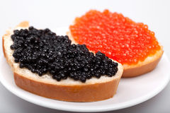 Two sandwichs with red and black caviar Royalty Free Stock Image