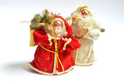 Two Santa Claus with christmas gifts. On white background Stock Photos