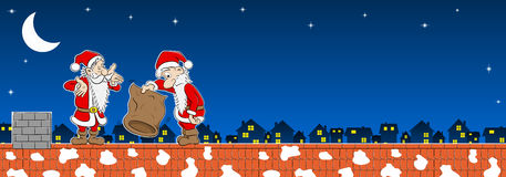 Two santa claus with empty bag on a rooftop Royalty Free Stock Photo