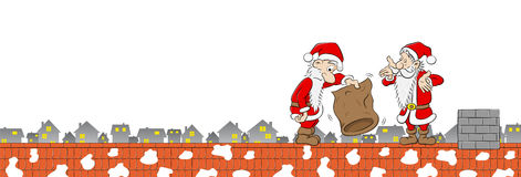 Two santa claus with empty bag on a rooftop Stock Photos