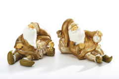 Two Santa Claus figurines royalty free stock photography