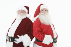 Two Santa Claus Standing Back To Back Royalty Free Stock Image