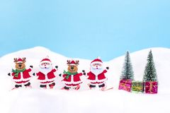 Two Santa Clauses and two reindeer with gifts Royalty Free Stock Image