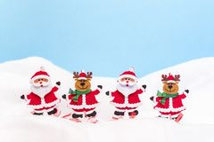 Two Santa Clauses and two reindeers Stock Image