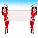 Two santa girl is holding white sign Royalty Free Stock Photos