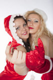 Two Santa Girls Having Fun Royalty Free Stock Image
